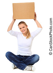 Lifting box - Attractive blonde woman lifting moving box....