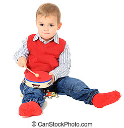 Music - Cute caucasian toddler playing with music...