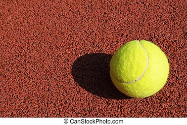 tennis ball on a tennis court - yellow tennis ball on the...