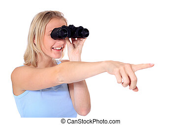 Vision - Attractive young scandinavian woman using spyglass....