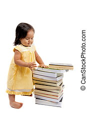 Pre-school  - Cute asian child girl looking at books .