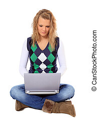 Communication - Attractive young woman using notebook...