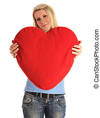 Red hart - An attractive young woman holding a heart-shaped...