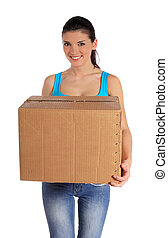 Woman carrying moving box - Attractive young woman carrying...