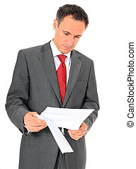Correspondence - Attractive businessman reading a letter....