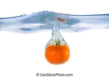 Tomato fell into the water. Close-up