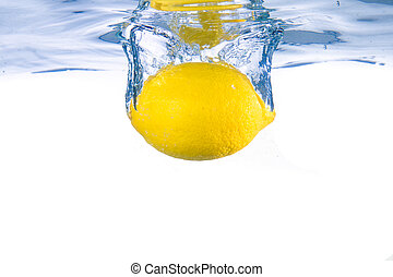 Lemon fell into the water. Close-up. Isolated on white.