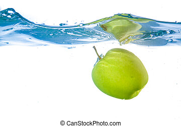 Apple fell into the water Close-up Isolated on white