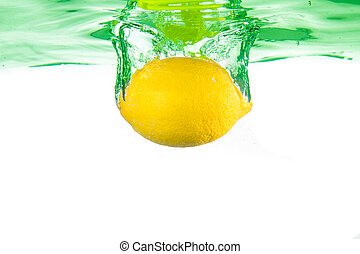Lemon fell into the water. Close-up.