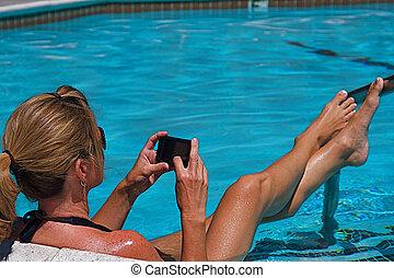Swimming Pool - Beautiful woman working on her...