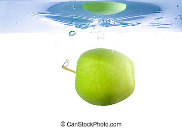 Apple fell into the water. Close-up