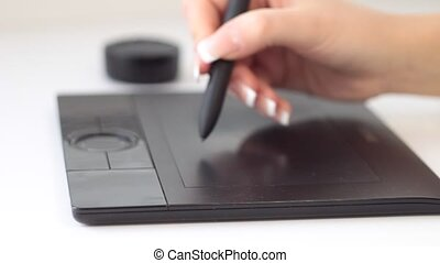 Hand on graphic tablet - Hand on graphic tablet