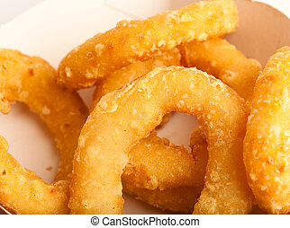 onion rings - fried onion rings on a white background