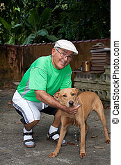 Senior Citizen Man and His Dog - An elderly Hispanic senior...