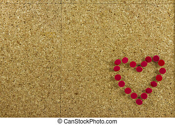 Corkboard background with red heart