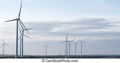 windmills for electricity production with cloudy sky