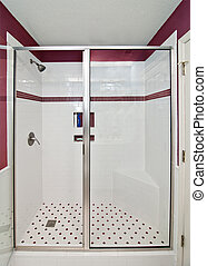 elegant modern shower with red tile accents