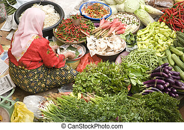 Vegetable Seller at Wet Market - Vegetable seller at a wet...