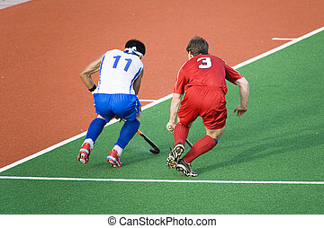 Field Hockey - Field hockey players in action at the Sultan...