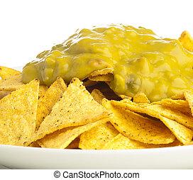 nachos - extreme closeup of nachos plate on white background