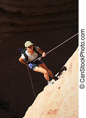 asian woman rappels - canyoneering asian woman rappels into...