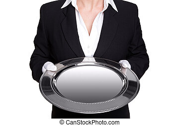 Female butler holding a silver tray isolated on white.