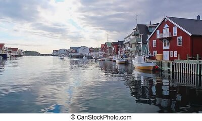 fishing harbour - traditional harbour with red wooden houses...