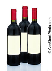 Red wine in wine bottles - Several red wine bottles on white...