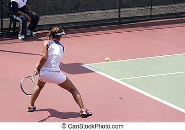 Junior Ladies Tennis - Junior ladies player in action at an...