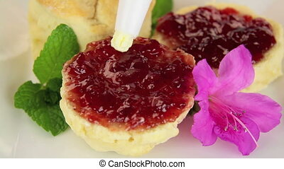 Cream On Scone - Piping sweet whipped cream on to a jam...
