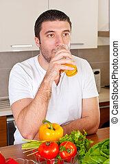 Mid adult man drinking orange juice - Mid adult man drinking...