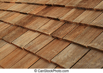 wood roof shingles - Diagonal detail of brown wood roof...