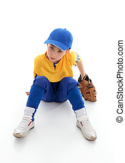 Young boy baseball t-ball player - A young boy dressed in...