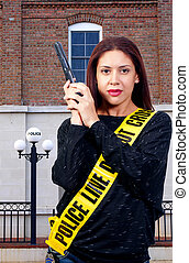 Woman with Gun - A young and beautiful woman holding a...