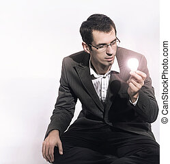 Businessman holding a light bulb