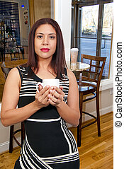 Woman Drinking Coffee - A beautiful young Hispanic Latino...