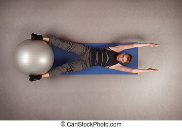 fit man exercising with large ball - Overhead view of man...