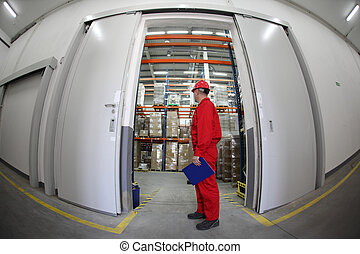 Worker standing in doorway - A fish eye view of a worker...