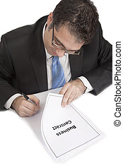 Businessman signing contract - Businessman signing business...