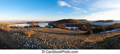 Autumn panorama with lake and hills