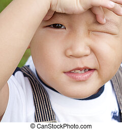 Confusion? - Little Asian boy is confusing, close up face.
