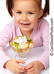 Little girl with fruit salad