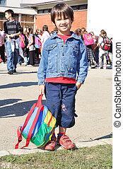 Happy children in front of the school, outdoor, summer to...