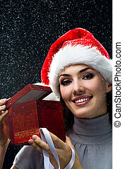 Christmas presents - young girl with christmas present in...