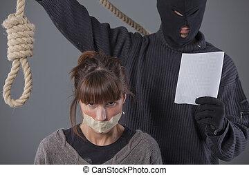 kidnapper demands ransom - kidnapper holding noose in front...