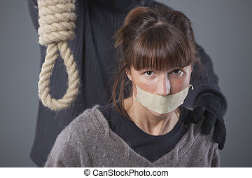 woman and hangman with noose - kidnapped woman and hangman...