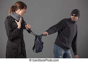 man mugging woman stealing her handbag