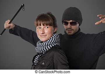 robbery - woman do not scent a danger from thief with...