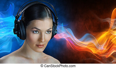 girl with headphones on the blue background
