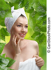 woman with bathtowel - a beautiful girl wrapped in the...